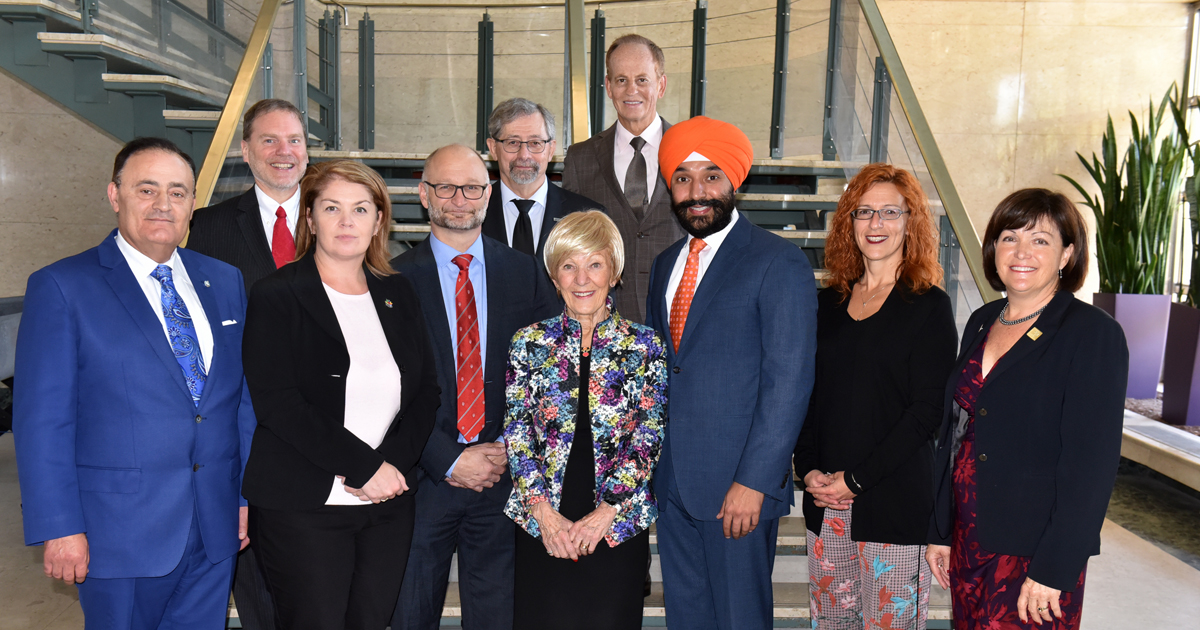 The Honourable Navdeep Bains, federal Minister of Innovation, Science and Economic Development, with Members of the Parlament and officers of Polytechnique Montréal