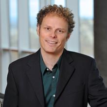 Intelligence artificielle : le professeur Christopher Pal présente des travaux de recherche à la conférence internationale NeurIPS 2018 à Montréal