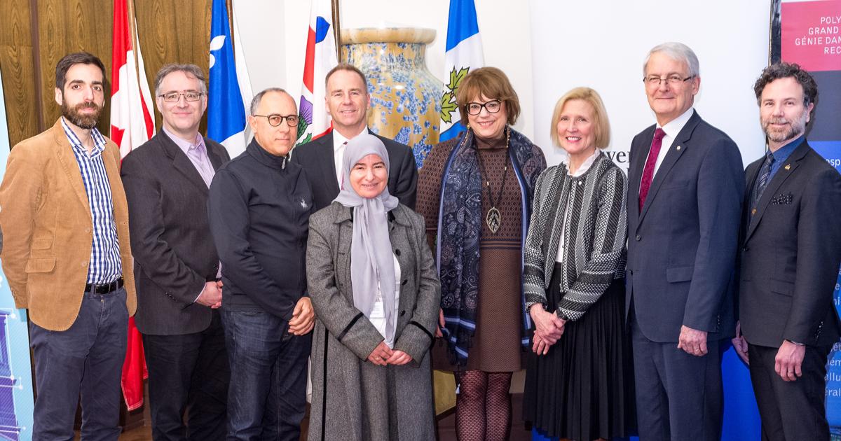 Des responsables des projets financés par le Fonds d'innovation à Polytechnique Montréal ou leur représentants, la ministre Hélène David, le ministre Marc Garneau, François Bertrand de la DRIAI et le maire d'arrondissement François William Croteau.