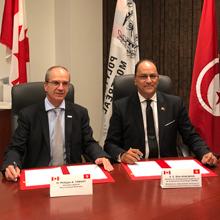 Philippe A. Tanguy, directeur général de Polytechnique Montréal, et Monsieur Slim Khalbous, ministre de l'Enseignement supérieur et de la Recherche scientifique du gouvernement de la Tunisie.